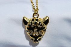 "Black & Gold Rhinestone Tiger / Leopard / Cougar 26"" Necklace & Charm, Pendant Size 1.25"" Value Line, http://www.amazon.com/dp/B0083VWZPQ/ref=cm_sw_r_pi_dp_Ykv2pb143H0JK"