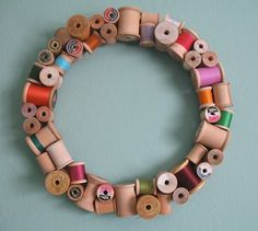 Wooden Spool Wreath-would be good for the spools I have that don't have enough thread for a project, would be a cool frame for a mirror