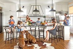 This rustic white kitchen is perfect for hosting kids and guests alike at this lake house