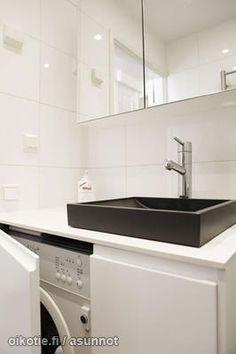 black sink. hidden washing machine.