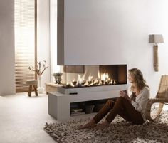 Futuristic Built-in Fireplaces Warm Modern Home Designs : Modern Home Design Interior With Electric Fireplace And Seagrass Chair On Rug With. Fireplace Modern Design, Home, Home Fireplace, Fireplace Design, Loft Design, Minimalist Fireplace, House Interior, Modern Fireplace, Interior Design