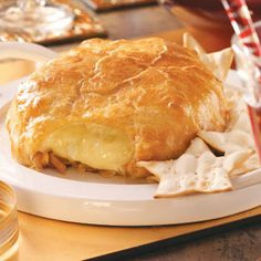 Brie in Puff Pastry 1 round ounces) Brie cheese cup crumbled blue cheese 1 sheet frozen puff pastry, thawed cup apricot jam cup slivered almonds, toasted 1 egg, lightly beaten Assorted crackers Finger Food Appetizers, Yummy Appetizers, Appetizers For Party, Finger Foods, Appetizer Recipes, Snack Recipes, Cooking Recipes, Snacks, Cooking Tips