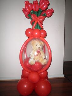 This balloon creation is approx. high has a teddy, 30 Cadbury roses chocolates inside the balloon hearts that are inside the clear balloon, 12 twisted red roses all on a balloon base. A great gift to let that special someone know you love them. Twisting Balloons, Clear Balloons, Balloons And More, Balloon Columns, Balloon Arch, Valentine Decorations, Balloon Decorations, Valentines Balloons, Valentines Day