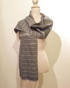 Handwoven Scarves | Marianna Nello Textile Design | 2017 Winter Collection | Handmade  Instagram: @Marianna.nello Etsy shop: https://www.etsy.com/shop/MariannaNelloTextile   Entirely handmade, handwoven scarf made with an 8-shaft table loom.  Technique used: free weaving (combining twill, plain weave, hopsack) Colors: Black, Gray, Pink  #handwoven #scarf #handwovenscarf #blackscarf #handmade #womenswear #accessories #grayscarf #weaving #woven #textiles