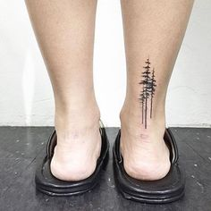 Pine tree tattoo on ankle                                                                                                                                                     More
