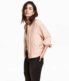 Dark gray. Jacket in soft, crinkled satin with a small stand-up collar. Zip at front, diagonal welt pockets, and wide elastication at cuffs and hem. Unlined