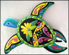 "Decorative Hand Painted Metal Turtle Garden Art - 16"" x 21"" . $42.95. Hand painted metal turtle wall hanging. Can be used both indoors and outdoors. The turtle is hand cut from recycled steel drum. The details of the design have been hammered into a bas-relief to accent the painted features of the turtle. There is a hanger on the back. This design is similar to the Mexican and Spanish talavera type painting style."