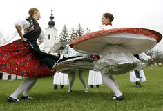"Hungarian youths dance as part of traditional Easter celebrations in Szenna, 189km (117 miles) southwest from Budapest April 2, 2010. Locals of village Szenna of Hungary, celebrate Easter with the traditional ""watering of the girls"", a fertility ritual rooted in Hungarian tribes' pre-Christian past, going as far back as the second century after Christ. REUTERS/Laszlo Balogh"