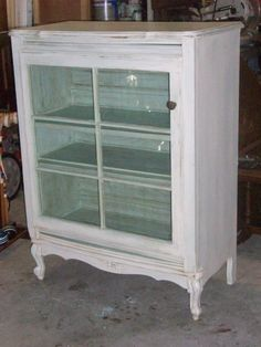 dresser turned into curio cabinet (the door is an old window :)