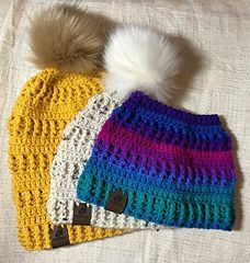 This pattern contains instructions on how to make the textured Crochet Brooklyn Beanie in 3 styles. The regular beanie, slouch beanie, and messy bun beanie.
