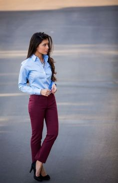 colored pants with tucked in denim colored button down shirt, add a statement necklace and some stylish leopard flats
