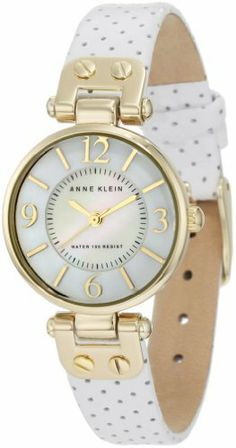 Anne Klein Women's 10/9888MPWT Leather Gold-Tone White Leather Strap Watch Anne Klein. $37.78. Perforated white genuine leather strap on gold-tone hinged lugs with stainless steel buckle closure. Petite 25 mm round case finished in polished gold-tone. Water resistant up to 100 ft.. Black printed inner minute track and gold-tone hour minute and second hands. Two-step white genuine mother-of-pearl dial with gold-tone arabic 3, 6, 9 & 12 markers. Gold-tone stick markers at all othe...