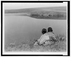 An idle hour, Piegan. Date Created/Published: c1910 December 8. Summary: Photograph shows two Piegan Indians sitting on grassy area above a body of water. Photograph by Edward S. Curtis, Curtis (Edward S.) Collection, Library of Congress Prints and Photographs Division Washington, D.C. Photo by Add this to feed
