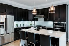 We are a general contracting company based in the west end of the GTA. From room renovations to full home remodels we can help. Ikea Cabinets, Black Cabinets, Kitchen Cabinets, Kitchen Black Counter, Black Counters, Waterfall Island, White Subway Tile Backsplash, White Quartz, Engineered Hardwood