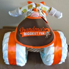 Diaper cake for a grandma shower - so she can have a few baby items and diapers at her house.