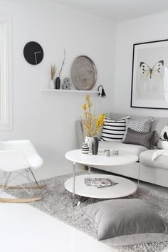 My favourite corner with the perfect play of elegant shades of white, black & gray. #CornerSeat #PureBliss