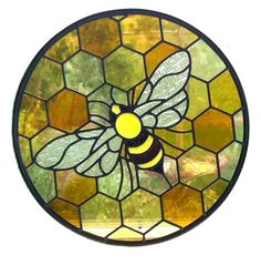 Bee with honeycomb background stained glass. Textured wings with antique glass