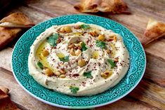 Hummus is one of those versatile dishes that can be used as an appetizer, snack, a dip, spread or as a side. I usually have a jar of hummus in my refrigerator and I change it up often by adding dif… A Food, Good Food, Tahini Paste, Salt And Ice, My Refrigerator, Flavored Oils, Truffle Oil, Hummus Recipe, Recipe Using