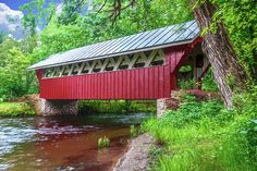 The Red Mill's covered bridge has completely refurbished from the natural wood and mossy shingled roof structure which stood for years. It's a beautiful bridge which should stand proudly for another 25 years.