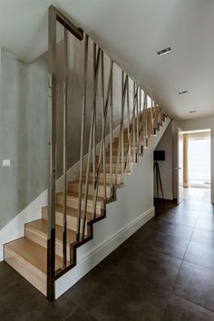 Located in Warsaw, Poland, this duplex apartment was designed by Hola Design. In the apartment we can find spacious living room with the kitchen, cozy ma House Staircase, Staircase Railings, Staircase Design, Minimalist House Design, Minimalist Home, Apartment 9, Duplex Design, Interior Design Photography, Modern Stairs