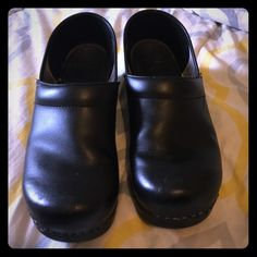 Dansko shoes Size 40 dansko shoes, preloved great condition there is sighns of wear and tear as you could see in the picture but in very good condition. Dansko Shoes Mules & Clogs
