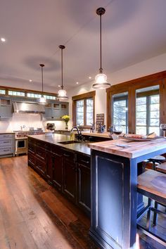 Lake Muskoka cabin. Urban Rustic Living.  I like the floors and the two tier island - lots of counter space
