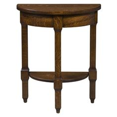 The Amish Heritage Royal Crest Half Round Table from DutchCrafters Amish Furniture. This contemporary end table with traditional details is a great option in a smaller living room since it sits against the wall, or as an accent for decor at the end of a narrow hallway with an alcove. Made to order in your choice of wood type and finish, this design features a half circle top with apron, open shelf, and three turned legs. Start designing your dream living room today. #solidwood #furniture