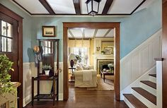Splendid Interior paint colors stained wood trim,Wall painting technique crossword clue and Painting interior trim tips. Natural Wood Trim, Dark Wood Trim, Stained Wood Trim, White Baseboards, Four Square Homes, Brown Doors, American Houses, House On A Hill, Home Remodeling