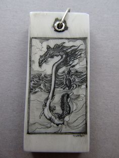 Items similar to Girl Riding a Dragon Hand Etched Scrimshaw on Antique Piano Key on Etsy Piano Crafts, Secret Compartment, Bone Carving, Whales, Craft Fairs, Altered Art, Hand Carved, Repurposed, Tooth