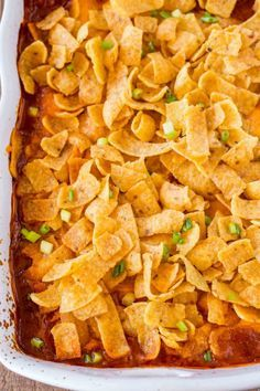 Cheesy Crunchy Frito Pie with ground beef, ranch style beans, cheese and enchilada sauce baked with crispy Fritos on top is a childhood favorite! Beef Casserole Recipes, Casserole Dishes, Meat Recipes, Mexican Food Recipes, Cooking Recipes, Dinner Recipes, Dessert Recipes, Hamburger Casserole, Crock Pot Recipes