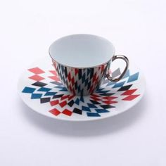 Cup & Saucer by D-Bros. Mirrored cup with patterned saucer