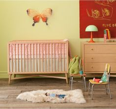 I love the idea of an uncluttered nursery...too bad its an illusion.