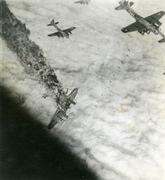 "The American B-17G ""Powerful Poodle"" takes a direct hit from flak over Ludwigshafen, Germany during her tenth, and last, sortie.  She went down at 11:25, Nov. 5, 1944.  All of the crew were killed.  Note the bombs falling from the plane above her."