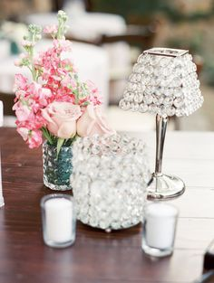 Pink Florals and Crystal Candle Lighting for the Centerpieces!