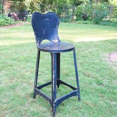 "Retro black metal chair / stool with great patina. This is a very versatile stool which can be used in many settings: kitchen, kids room, bedside table or outdoor side table. The form of this chair is just perfect with that adorable heart shape of the seat back! This vintage stool a little rust and chips on the paint which gives it a super patina. It is structurally very sound. It has been repaired with two rivets on the back. Measurements: 30""h x 12""w; seat 20""h x 11.5""w Industrial Chair, Vintage Industrial, Kitchen High Chairs, Black Metal Chairs, Paper Plate Holders, Vintage Stool, Outdoor Side Table, Metal Stool, Mid Century Furniture"