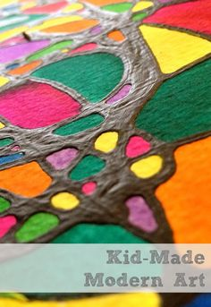 fun and easy kid made modern art using black glue and watercolors