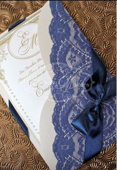 Wedding invite with navy blue lace and ribbon