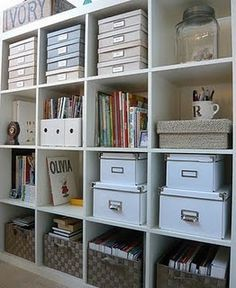 Organized office space with lots of boxes- looks so neat and tidy