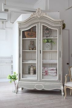Gorgeous French Provincial armoire! The chicken wires on the doors lend French…
