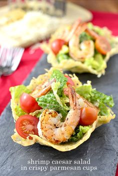 Shrimp Caesar Salad in Crispy Parmesan Cups by Iowa Girl Eats. I came up with the idea for Shrimp Caesar Salad in Crispy Parmesan Cups while brainstorming what I'd make Ben and myself for Valentine's Day dinner. I literally sat straight up on the couch when inspiration struck. Ben asked me what was up but then went back to playing pool on his iPhone before I could finish explaining. Ugh. That damn game. I suppose it's better than Plants vs Aliens. I just…can't.