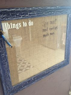 """Turn an old picture frame into a message board!  Materials: Old frame, Crackle medium (I used Martha Stewart's brand), Paint (I used white as my """"under the crackle color"""" and then navy blue as my top color, Material to fill inside of frame (I chose burlap), Alphabet stickers, Dry erase marker, Twine (so the marker can hang freely)"""