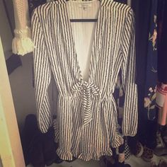Lucy paris romper Striped romper size small. Perfect condition worn ONCE to dinner.  Tie front , low but can be concealed more with fashion tape.  Ruffle hem on shorts and elastic around wrists. Lucy Paris Other
