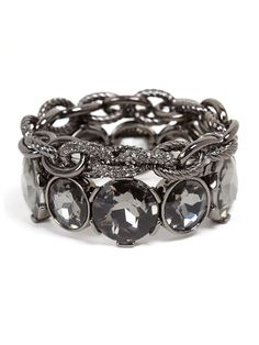 Take a classic look up a notch with oversized crystals cast in this season's hottest metal: hematite.  Add a few classic links and you've got the perfect edgy-glam stack.