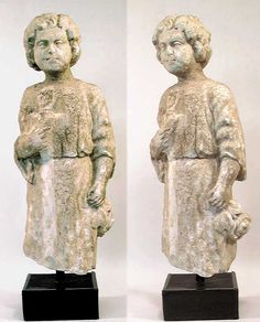 AN IMPORTANT ROMAN MARBLE FIGURE OF A YOUTH. c. 2nd-3rd century AD.