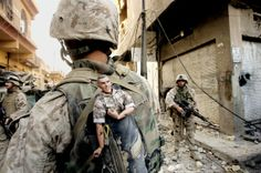 US marine carrying a lucky mascot as his unit pushes further into the western part of Fallujah won a Pulitzer prize in breaking news photography in 2004.  By AP photographer Anja Niedringhaus was shot dead in Afghanistan