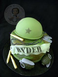 Camo birthday cake.  Army helmet, grenades, dog tags and bullets are all edible.