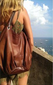 So glad that our bags are hanging around CAPRI! - The Tan Talega
