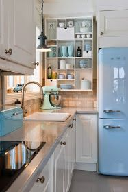 Kitchen Shelf Cubbies - this is a creative and inexpensive way to add storage to the kitchen without closing in the space.