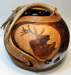 Beautifully designed and hand crafted works of fine art from gourds. Jennifer Hershman artist