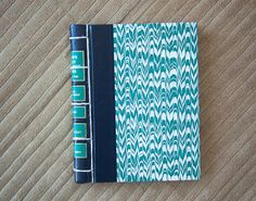 Nothing better than a sturdy and attractive journal. And diary writing can be a great way to learn more about yourself. (vintage hand made journal // hard bound journal. $23.00, via Etsy.)